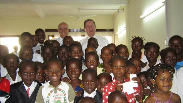CAR Elder Holland and Ckayton with the Bangui children