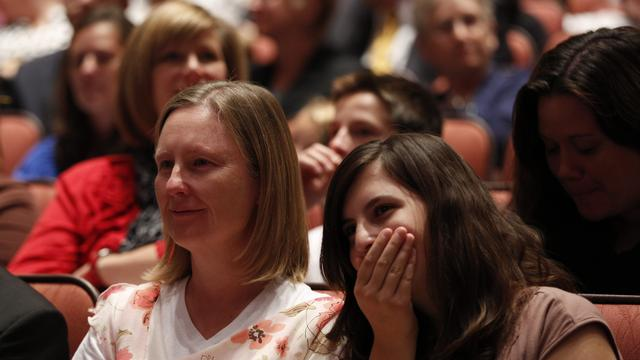 Conference goers react to President Thomas S. Monson's announcement of lower age requirements for missionaries at the Saturday morning session of general conference, 6 October 2012
