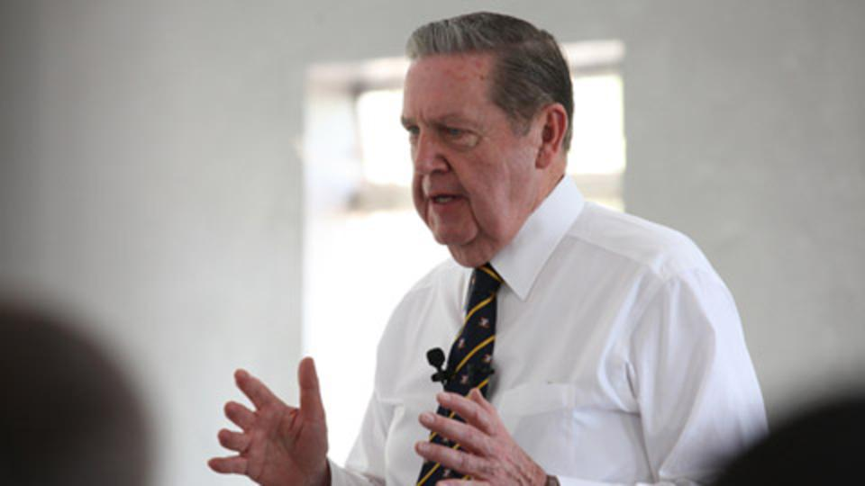Elder Holland teaching the members of The Church in West Africa